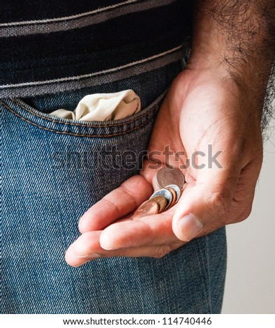 Disappointed man with empty pockets. Unemployment - stock photo