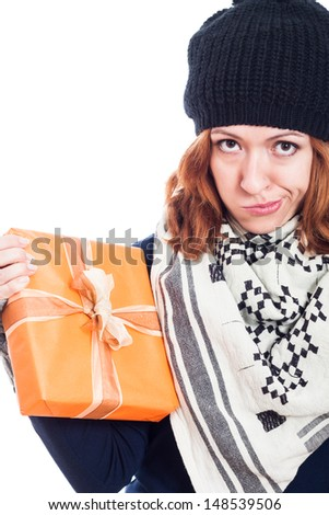 Disappointed woman holding present, isolated on white background. - stock photo