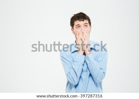 Disappointment man standing isolated on a white background - stock photo
