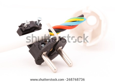 disassembled electric plug and power cord - stock photo
