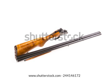 Disassembled hunting rifle isolated on white - stock photo