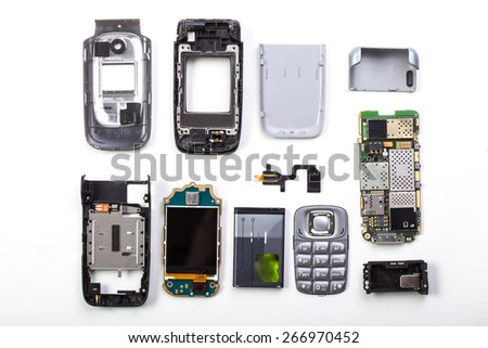 Disassembled mobile phone on white background - stock photo