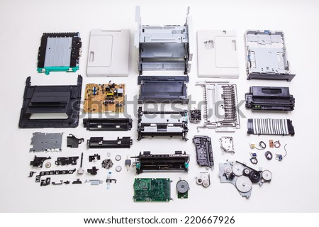 Disassembled printer on a white background.