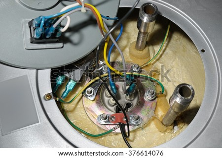 Disassembled water heater for repair