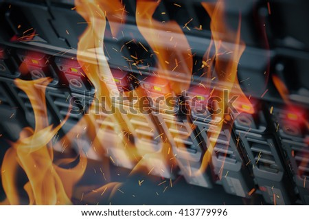 Disaster in data center room server and storage on fire burning - stock photo