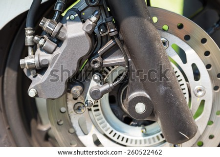 Disc brake of eco motorcycle, , scooter motorcycle background
