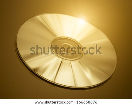Disc on a golden background - stock photo