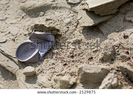 Discarded aluminum can in the desert - stock photo