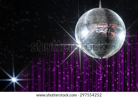 Disco ball with stars in nightclub with striped violet and black walls lit by spotlight - stock photo