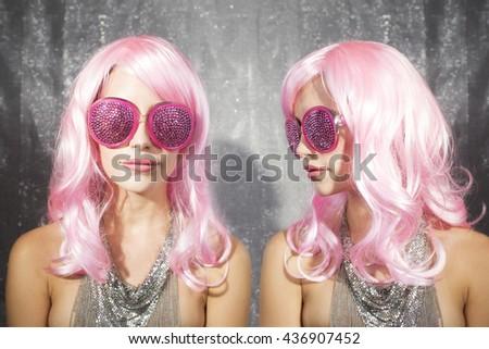 disco twins gossip. two cute club characters in a nightclub setting - stock photo