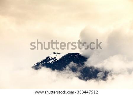Discrete View Of The Tungurahua Volcano On Through The Clouds  - stock photo