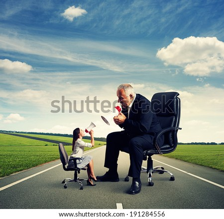 discussion between emotional small woman and big man at outdoor - stock photo
