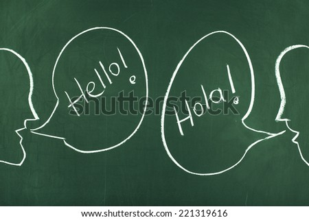 Discussion in english and spanish - stock photo