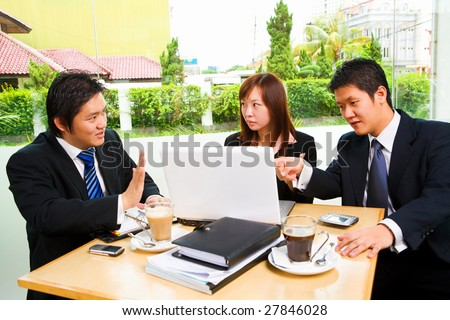 Discussion of Chinese businesspeople - stock photo