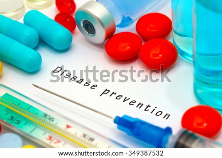 Disease prevention - diagnosis written on a white piece of paper. Syringe and vaccine with drugs. - stock photo