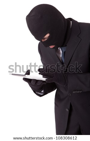 Disguised computer hacker in suit and tie - stock photo