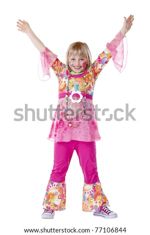 Disguised young girl smiles and holds hands up. Isolated on white background. - stock photo