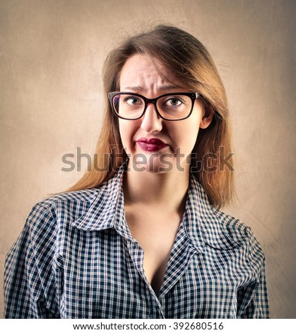 Disgusted girl - stock photo