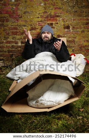 Disgusted homeless - stock photo