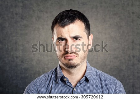 Disgusted man - stock photo
