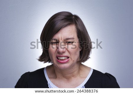 Disgusting mature woman on blue background