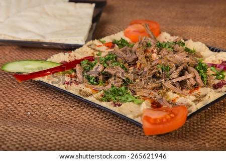 Dish delicious food. Appetizing food. Eastern food, Arabic food. - stock photo