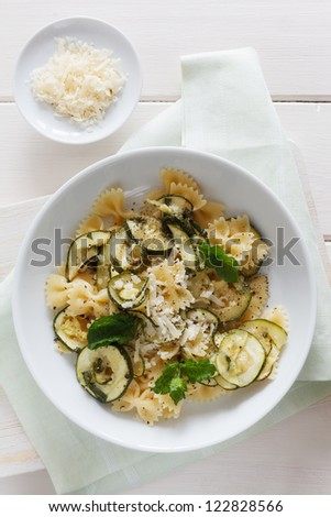Dish made from gluten free pasta and zucchini.