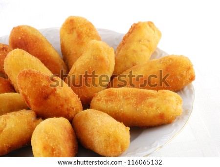 Dish of croquettes of beef and ham - stock photo