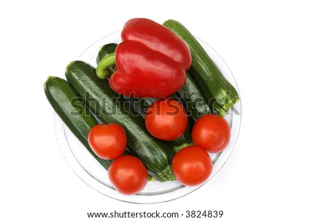 Dish of fresh zucchini, tomatoes and a red pepper - stock photo