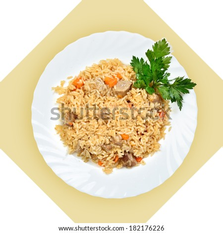 Dish of fried rice with meat(pilaf) on white plate. Isolated image with white background. View from above. still life of setout table Russian cuisine