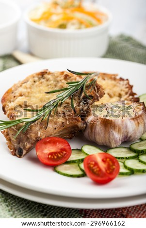 Dish of pork chops with vegetables