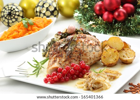 dish of roasted turkey breast on a christmas table  - stock photo