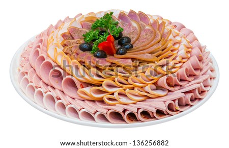 Dish of varieties bologna sausages arrangement decoration with Pickle black olives - Bell Pepper and Parsley isolated on white - stock photo
