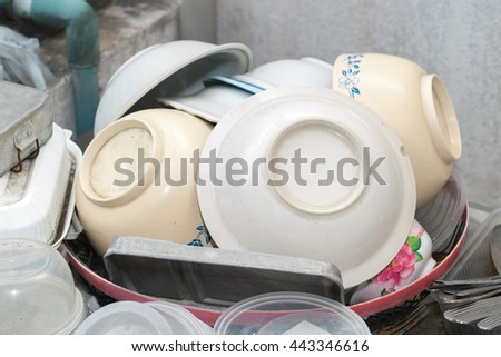 Dish&plate stack in plastic basket after washing  - stock photo