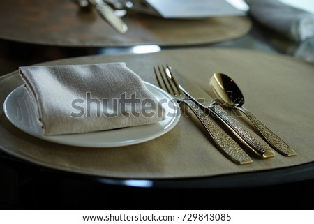 https://thumb9.shutterstock.com/display_pic_with_logo/167494286/729843085/stock-photo-dish-spoon-fork-knife-on-the-table-729843085.jpg