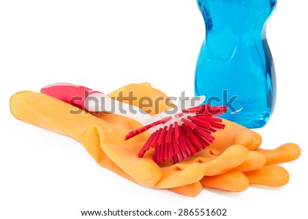 Dish washing brush with rubber gloves and detergent over white - stock photo