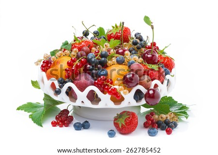 dish with fresh seasonal fruit and berries, isolated on white - stock photo