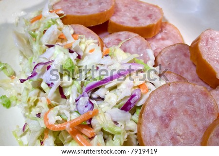Dish with sausage and cold slaw - stock photo