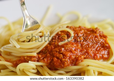 Dish with spaghetti and bolognese sauce