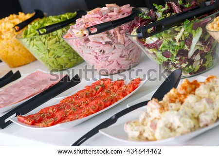 Dishes of assorted food for salad buffet in a restaurant - stock photo
