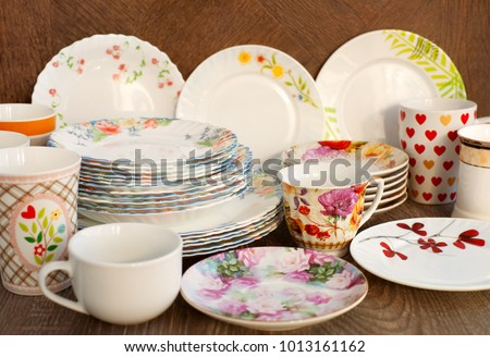 Dishes of different kinds. A lot of dishes are collected together. Plates saucers & Dishes Different Kinds Dishes Collected Together Stock Photo ...