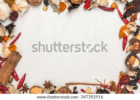 Dishes prepared with medicinal herbs Chinese medicine frame - stock photo