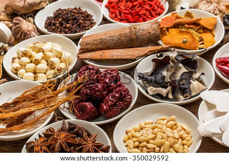 Dishes prepared with medicinal herbs Chinese medicine health longevity - stock photo