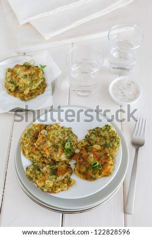 Dishes with zucchini pancakes. - stock photo