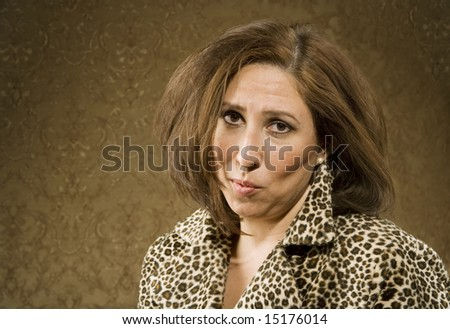 Disheveled Hispanic Woman in Leopard Print Coat with Messy hair - stock photo