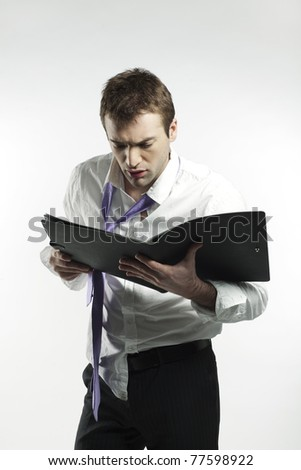 dishevelled businessman in  trouble - stock photo
