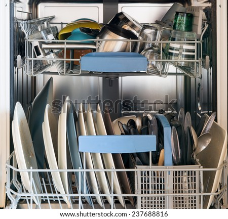 dishwasher with dirty dishes - stock photo