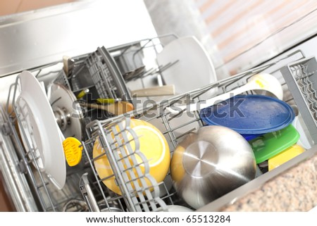 dishwasher with dirty dishes (selective focus with shallow DOF) - stock photo