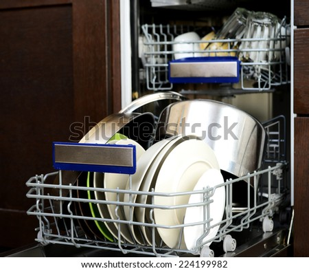 dishwasher with dishes and glasses - stock photo