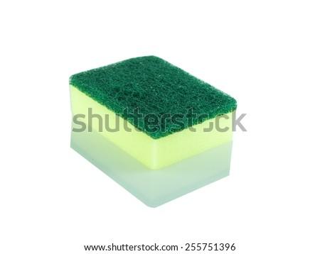 Dishwashing green sponge and yellow - stock photo